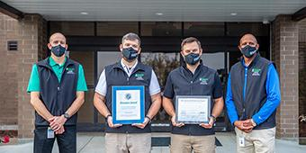 Water Resouces employees Anthony Whitehead, Dail Booth, Chad Flannagan, and Julius Patrick.